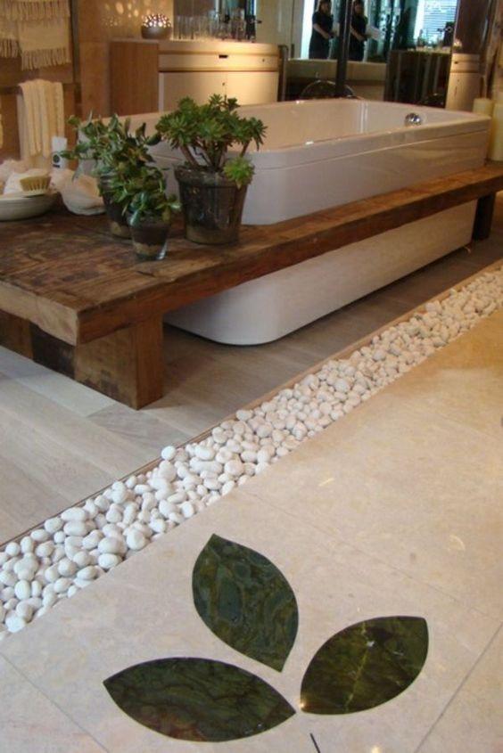 On d core la salle de bain avec des galets floriane lemari for Gallet salle de bain